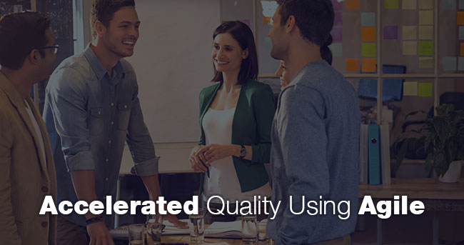 Three men and two women standing around a table. Title: Accelerated Quality Using Agile