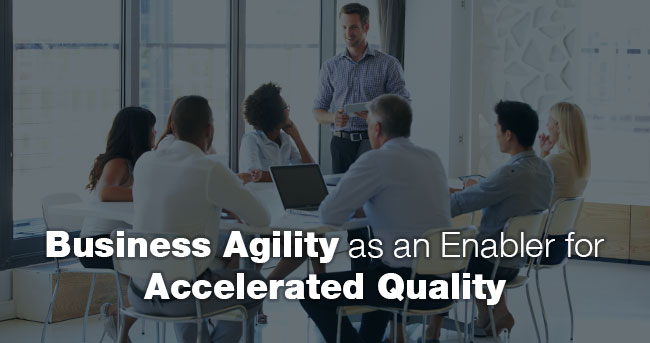 Image: Seven people sitting at a table listen to one person speaking while standing. Title: Business Agility as an Enabler for Accelerated Quality