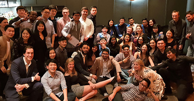 Group photo of Cherie at a Planit company party