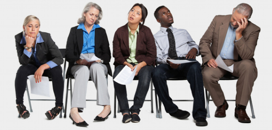Five people of varying age, ethnicity and gender with body language depicting inattentiveness