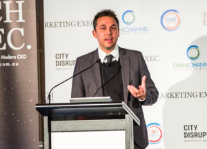 Joel Deutscher presenting 'Don't Let Performance Disrupt You' at CxO Disrupt Sydney